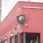 The sign for this bar is a lion's head.  The lack of a name or even what the place is gives me a sense of uninvited. Maybe thats the intent?